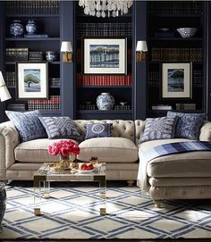 I can't get my eyes off this gorgeous library! The contrast between the tufted beige linen sofa and the dark navy built-in bookshelves are ...                                                                                                                                                                                 More