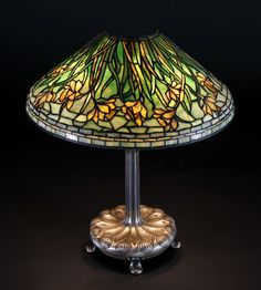 "Tiffany Studios, NY, Daffodil Lamp    Base sgn. Tiffany Studios, NY 26876. Tiffany Glass & Decorating Co. mark on base. Ht. 26"" Shade dia. 28"""