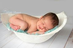 Newborn in belly cast