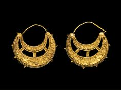 PAIR OF BYZANTINE GOLD CRESCENT EARRINGS  Decorated with filigree.  6th-9th Century AD