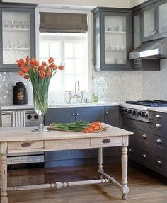 Gray cabinets, light bleached oak floors, pickled island
