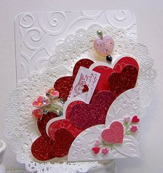 Like a bouquet of hearts on front of card with doilie. Nellies Nest