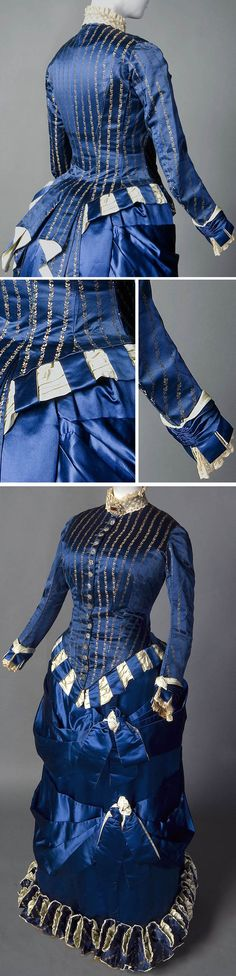 """Two-piece day or dinner ensemble in deep blue, Emile Pingat, ca. 1883-85. Silk satin, silk jacquard, cut steel buttons, polished cotton lining. Overskirt missing. Bodice cut in """"tailor-made"""" style, fitted with button closures, cuffed sleeves, & tail similar to a man's tail coat. Tabs of silk at cuffs and panings of blue satin holding drape of pale green satin at hips were features used in the Renaissance. Smith College Historic Clothing"""