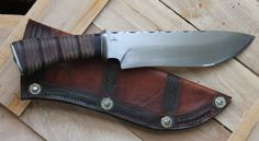 8 inch 1095 carbon steel blade, with file work. 13 1/2 inch over all. Leather stacked handle with african black wood. Very comfortable in the hand.