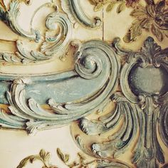 This is a photo of a beautiful piece of blue painted carving in the Palace of Versailles