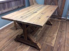 Nice table built using reclaimed barnwood, love the character