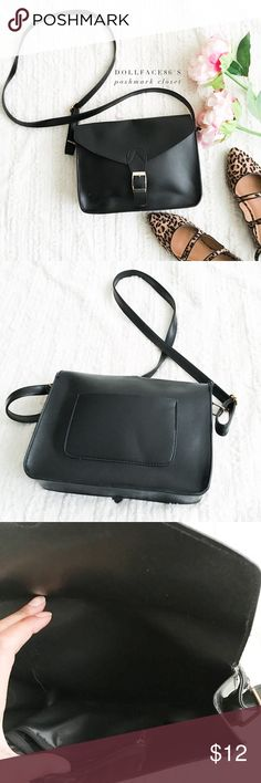 """Black Cossbody Purse This black cross body purse has a faux leather like material with a gold hardware magnetic snapping buckle, the strap adjust.  {I am not a professional photographer, actual color of item may vary ➾slightly from pics}  ❥width:9.5"""" ❥length:8"""" ❥pockets:1 open exterior/1 zippered interior  ❥strap:51"""" at longest ➳material:no tag, maybe polyurethane?  ➳condition:has a part of strap that needs mending   ✦20% off bundles of 3/more items ✦No Trades  ✦NO HOLDS ✦No transactions…"""
