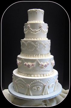 Vintage Ivory Buttercream Wedding Cake by Graceful Cake Creations, via Flickr