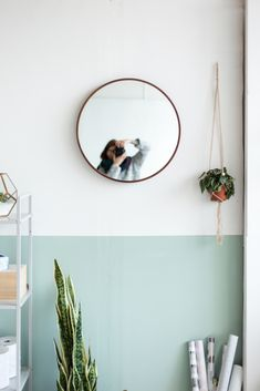 Half painted wall in white and teal