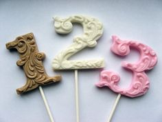 Beautiful filigree-style alphabet and number lollipops! Buy one of these typographic treats from VintageConfections.