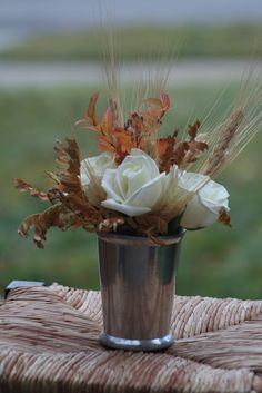 I like the size of this as the medium sized component of the centerpieces (the larger flower arrangements). pair with a small pumpkin or candle and a large vessel (with the table number) of cranberries or stones