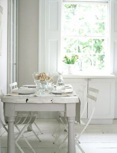 simple and pretty white dining area