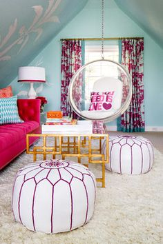 Kind of like the stencil on the wall and also that pink couch. Love the color blue wall and floor poufs!