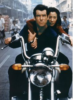 "Pierce Brosnan as Bond and Michelle Yeoh as the Bond-girl Wai Lin, handcuffed together on a motorcycle, in a scene from the 1997 James Bond movie ""Tomorrow Never Dies."""