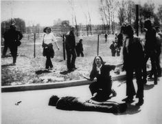 85.) This photo of a young woman next to her murdered friend came to symbolize the tragedy of the 1970 Kent State Massacre.