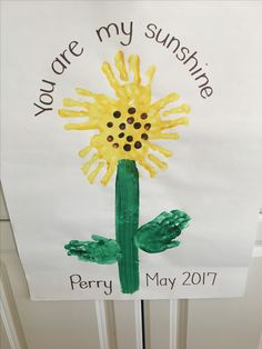 """Preschool Mother's Day or spring craft. This is a great activity that uses children's hands to create a flower (in this case, a sunflower). """"You are my sunshine"""" is written across the top."""