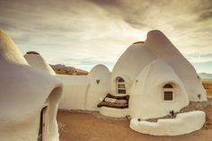 """The Bonita Domes in Joshua Tree, California, are sustainable dome structures known as """"Earthbags"""" built right from the earth beneath them. You can rent a dome pod on your next visit and create your own unique desert living experience!    Check out the video we created on the Wanderfoot digital magazine:     http://wanderfoot.com/bonita-domes/"""