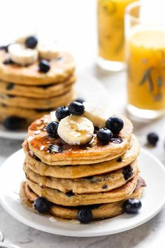 These are the BEST Blueberry Protein Pancakes ever! This easy homemade, from-scratch recipe is made with healthy ingredients like almond flour and eggs. SO fluffy and delicious – plus they're gluten-free! Great for clean eating. Delicious Breakfast Recipes, Snack Recipes, Pancake Recipes, Free Recipes, Blueberry Protein Pancakes, Protein Muffins, Healthy Lunches For Kids, Healthy Breakfasts, Pancake Calories
