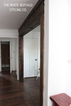 """faux-beams. I love the look of this. Makes the entire doorway look so much more substantial. Something else to add to my """"honey do"""" list...lol"""