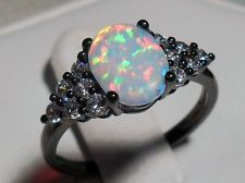 COLD AS ICE WHITE FIRE OPAL SILVER AND BLACK GOLD FILLED RING #opalsaustralia