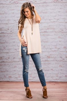 """""""Slide On Over Tee, Peach""""The tee is far beyond just a regular old casual tee! Have you seen those side slits?! The drama!! We just love it! #newarrivals #shopthemint"""