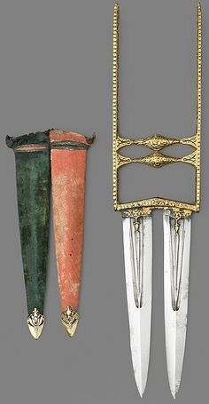 Indian katar (push dagger), 19th century, russet iron, gold, watered steel, wood, velvet and silver, Length: 18.4 cm, blade, The Wallace Collection.