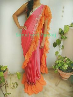 Beautiful soft flowy smooth frills pink and orange color combination saree.Whatsapp for orders and booKings at 02 August 2017 Saree Gown, Organza Saree, Lehnga Dress, Indian Dresses, Indian Outfits, Desiner Sarees, Sari Design, Simple Sarees, Red Bridesmaid Dresses