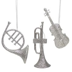 Let your love of music ring clearly through your home decor with these champagne silver glitter drenched musical instrument ornaments Fully dimensional ornaments Come ready-to-hang on silver cords Dim
