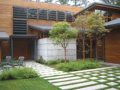 I love how the pavers mimic the windows. Beautiful landscape architecture.