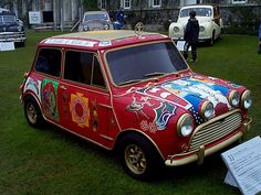 """George Harrison George Harrison was gifted this 1965 Radford Mini Cooper S, originally painted Metallic Black. In 1967, the car was repainted and featured in the Beatles TV movie """"Magical Mystery Tour""""."""