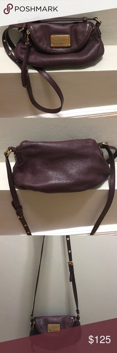Marc by Marc Jacobs Crossbody Bag Beautiful eggplant colored crossbody! This bag was used very little. There is no noticeable wear or damage aside from very faint scratches on the nameplate. There is one interior zipped pocket, two smaller open pockets, and the flap on top is itself a larger compartment. Marc By Marc Jacobs Bags Crossbody Bags