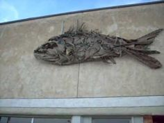 ▶ Sculpture: Fish made of driftwood mounted on building - YouTube