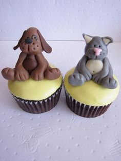 Cat and Dog Cupcakes by clevercupcakes, via Flickr