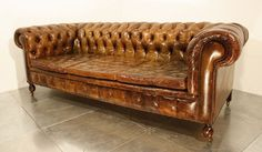 A vintage 1920's leather chesterfield sofa. || look, sit if you must, don't stay for long.