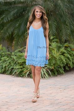 This sweet lace dress is so perfect for relaxing with friends and having a fabulous summer night! The bodice is simple and comfortable, with a scoopneck and spaghetti straps. It also has a low-cut v in back and super comfortable fabric you'll want to wear all day long.