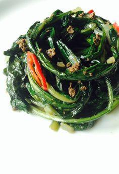 SAUTEED DANDELION GREENS with TOASTED BELACAN CRUMBLES [Southeast Asia, Modern] [rojaksingapura]  [dried shrimp paste, shrimp sauce, belacan, man ruoc, mam tom, mam tep, bagoong alamang, kapi, terasi, ngapi yay, hom ha, hae ko, petis udang, haam ha, ha jeung, galmbo, sidol, nuppi] Nettle Recipes, Real Food Recipes, Cooking Recipes, Sauteed Greens, Flower Food, Edible Flowers, Recipe Using, Japchae, Vegetable Recipes