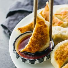 I love these homemade pan-fried Chinese dumplings filled with ground beef and sliced scallions. Also known as potstickers, they're easy to make.