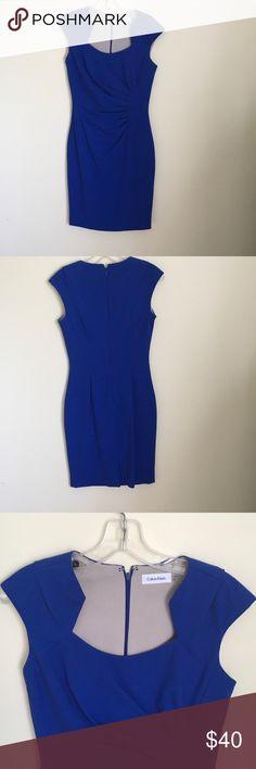 "Calvin Klein Sapphire Blue Dress sz2 Calvin Klein Sapphire Blue Dress. Great condition, size 2, fitted in back, shirred in front, detailed neck line, cap sleeve, lined, slit in back. Shoulder to hem 37.5"". Calvin Klein Dresses Midi"