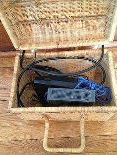 Hide your modem and router inside a decorative basket. The lid serves as protection from dust. Created and posted by Crys Galivan.- a small basket might work in my home Router Box, Hide Router, Hide Computer Cords, Hide Wires, Cord Hider, Hide Cable Box, Old Wooden Boxes, Beige Living Rooms, New Home Designs