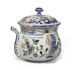AN ENGLISH DELFT POSSET-POT AND A COVER  CIRCA 1710-30, POSSIBLY LONDON OR BRISTOL  Of typical form, the domed cover with mushroom finial, the spout and flanking flat strap handles with blue dashes, painted with floral bands and with a continuous scene of birds among flowering vine  8 3/8 in. (21.3 cm.) high, 10 in. (25.4 cm.) wide (2)
