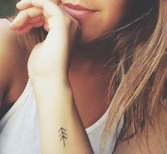 A simple pine tree. 61 Impossibly Tiny And Tasteful Tattoos