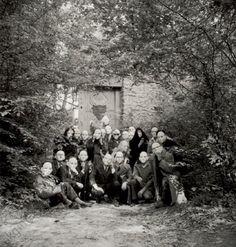 c. 1960. Surrealists wearing masks at a gathering at the Désert de Retz, France (André, Elisa and Aube Breton, G.Goldfayn, Toyen, E.Jaguer, G.Legrand, N.Espagnol, A.Joubert, R. Benayoun, J.Pierre, M.Van Hirtum and others). Group photo, April 1960, by Denise Bellon (1902–1999).