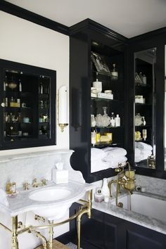 Matchbook Magazine: Black and gold bathroom design with black inset medicine cabinet over antique brass ...