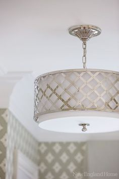 A modern drum-shade ceiling light.