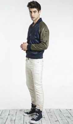 Shop this look on Lookastic:  http://lookastic.com/men/looks/navy-bomber-jacket-white-skinny-jeans-black-and-white-high-top-sneakers/9356  — Navy Bomber Jacket  — White Skinny Jeans  — Black and White High Top Sneakers