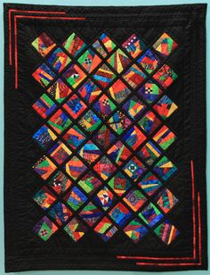 """Wall Quilt 16, """"Chaos in Motion"""" by Jeanne Brenner  """"The instructions for this pattern were accidentally left at my house after a morning with Bits and Pieces members selecting patterns and fabrics for future charity quilts. With no matching points or symmetry to worry about, the top came together in a few days using scraps from previous projects. The contrast of black fabric with bright colors always makes me smile."""" Capital City, Black Fabric, Bright Colors, Make Me Smile, Charity, Contrast, Scrap, Fabrics, Quilts"""