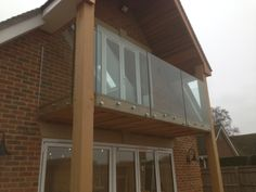 Frameless glass balustrade to balcony, supplied and fitted by Morris Fabrications Ltd. Frameless Glass Balustrade, Balcony, Garage Doors, Outdoor Decor, Home Decor, Interior Design, Home Interior Design, Outdoor Balcony, Home Decoration