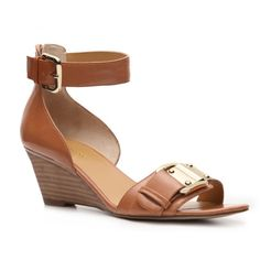 Just bought these at DSW on clearance for $42. Nine West Possible Wedge Sandal Sandals Women's Shoes - DSW ($60) found on Polyvore