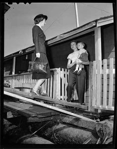 Victorian Order of Nurses nurse visits mother and child on houseboat VPL Accession Number: 81028 Date: September 1949 Photographer / Studio: Artray Content: Photo series A-B Topic: Nurses Houseboats September 9, Houseboats, Photographic Studio, Slums, Photo Series, Mother And Child, Nurses, Vancouver, Past