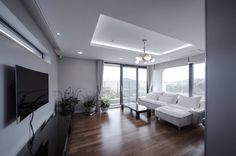 평창동주택 : 모던스타일 거실 by (주)건축사사무소유오에스